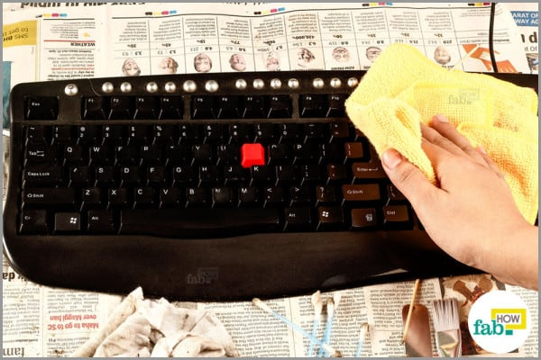 cleaning the keyboard with dry dusting cloth