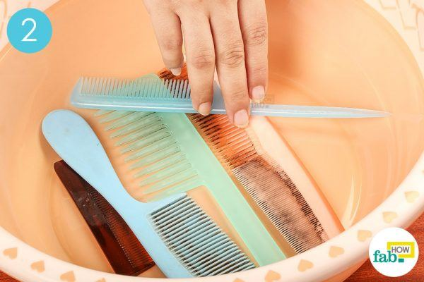 put dirty combs in a tub to clean a dirty hair comb