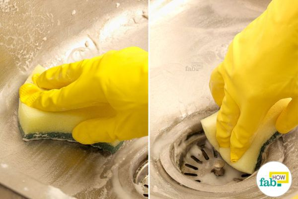 Scrub the sink to clean stainless steel sink