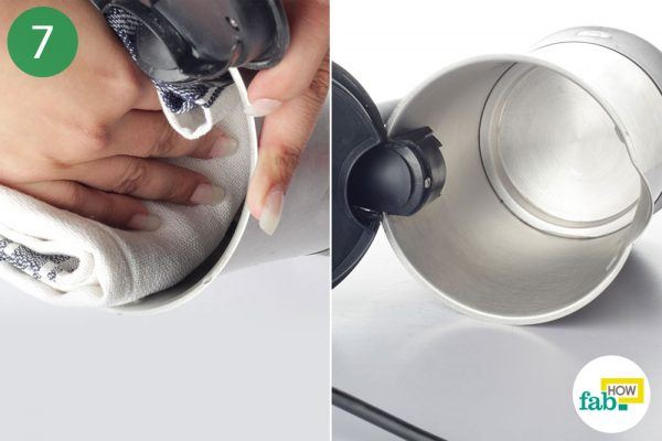 wipe the inner surface to clean limescale from electric kettle