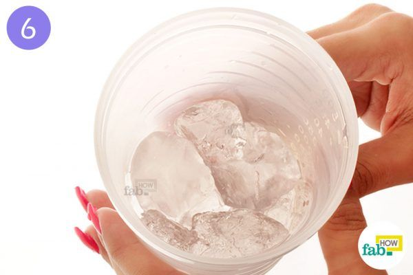 Put ice cubes in a shaker