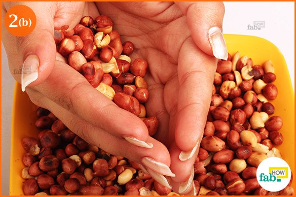 Rub peanuts in your hand