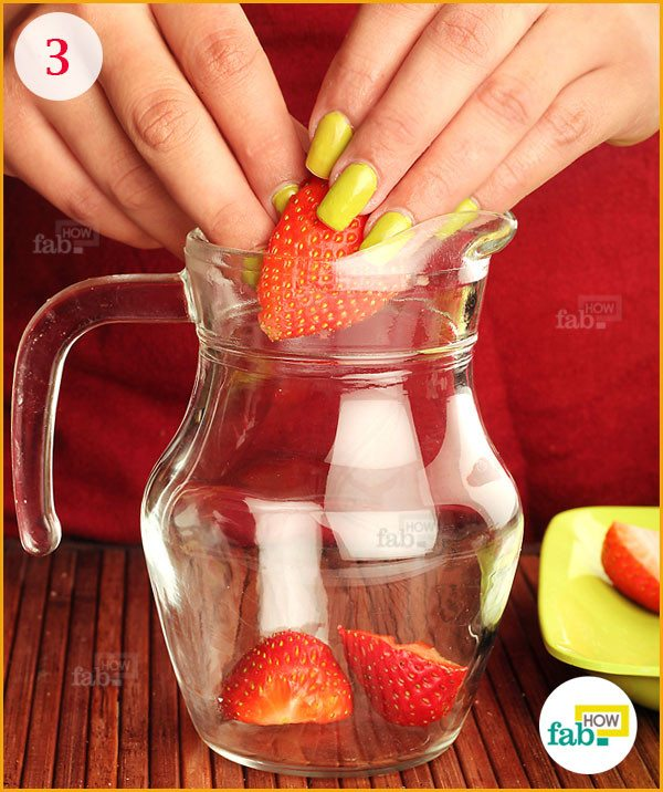 Put strawberries in the pitcher