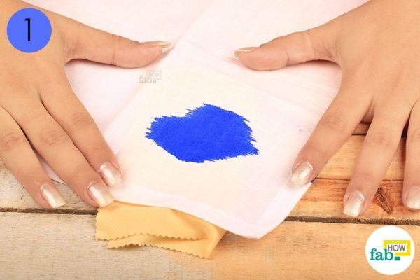 use a light colored cloth underneath to remove ink stains from clothing