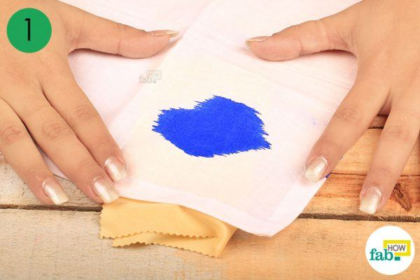 place a light-colored cloth underneath the ink stain fabric
