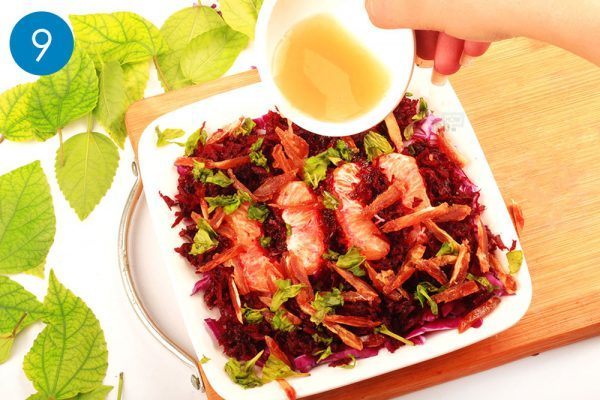 pour orange juice for red cabbage salad
