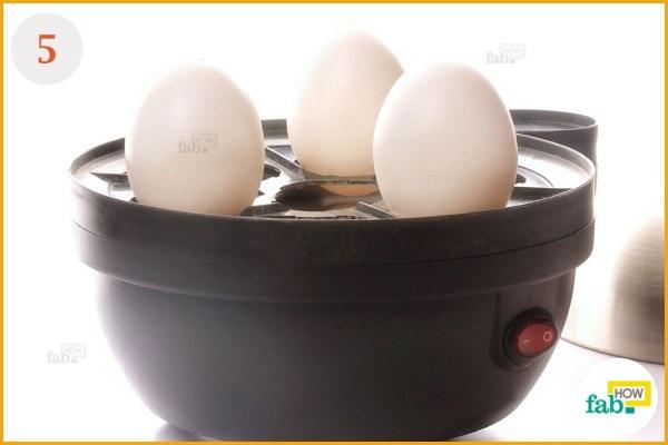 Place pierced eggs in boiler