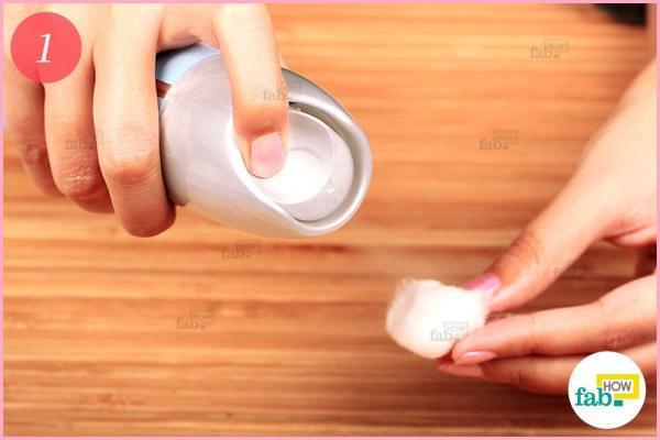 Spray hairspray on cotton ball