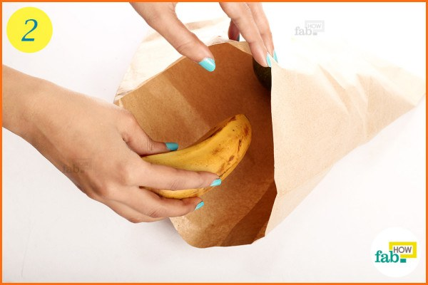 Put a ripe banana in the bag