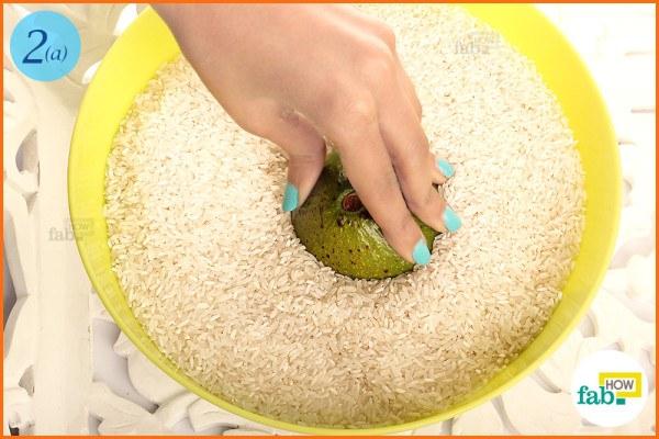 Bury unripe avocado in rice