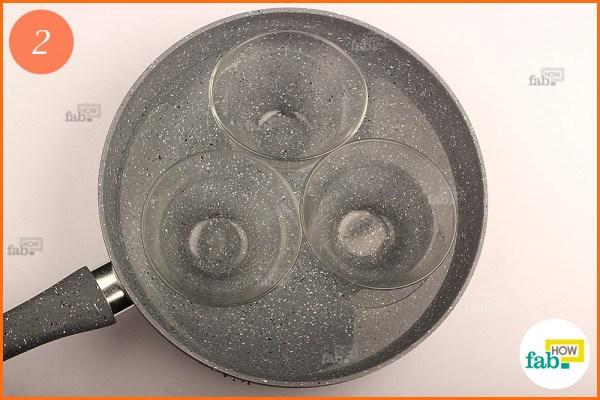 Place heatproof bowls in pan