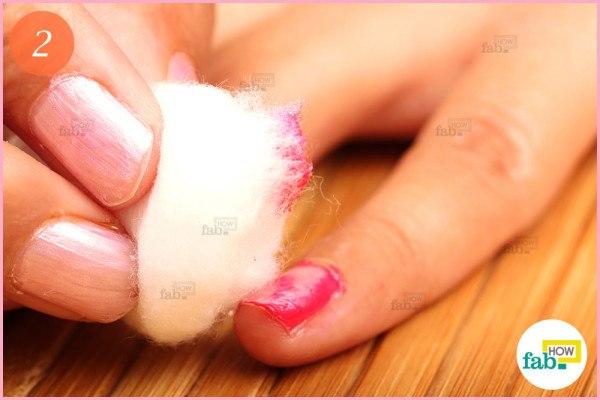 Remove the polish using cotton ball