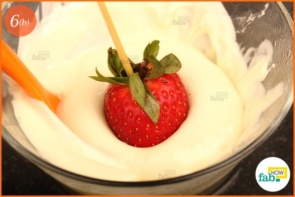 Dip strawberry in white chocolate
