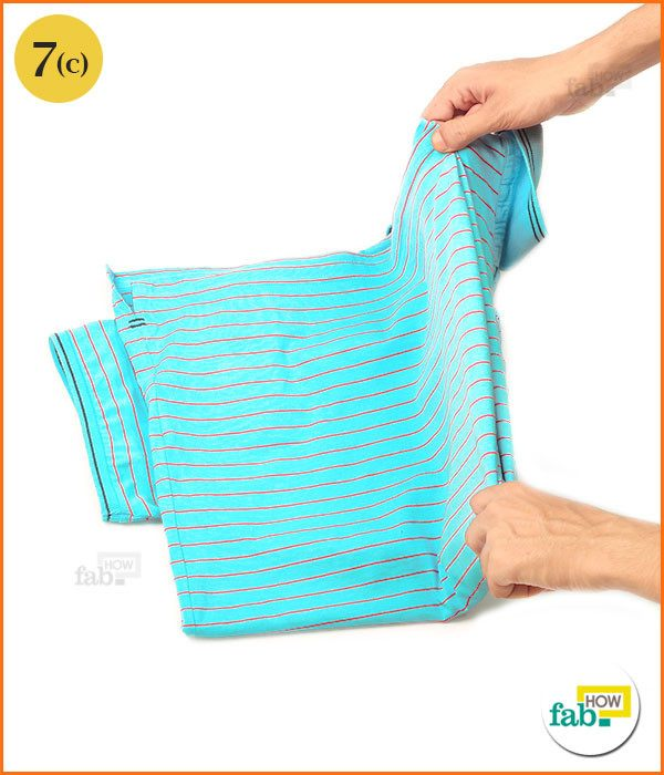 Fold the shirt over loose sleeve