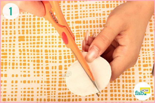 Cut cotton pads in half
