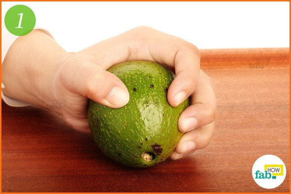 Hold and press green avocado