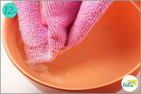 Soak a towel in water