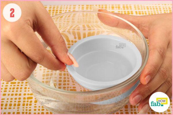 Warm acetone in a water bath