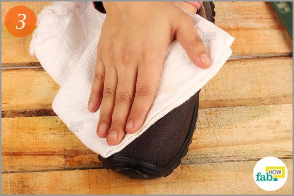 Dry the shoe with lint free towel