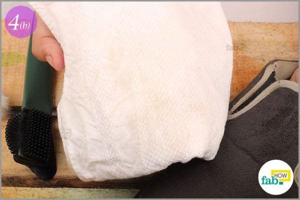 Dry the shoes with lint free cloth