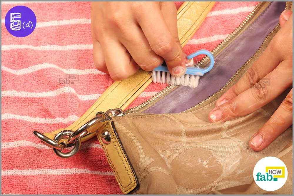 Use a nail brush to clean the nooks and crannies of your bag as well as the  zippers. A nail brush like the one used here is designed to be used on ... 0b2bc9b5c5