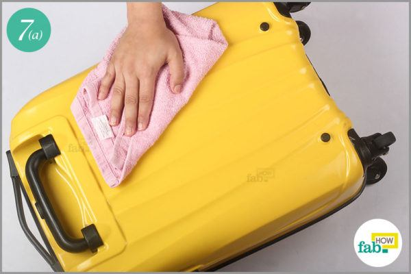 Wipe down the suitcase with a towel