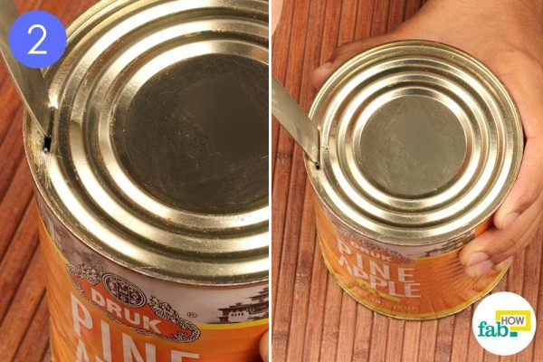 pierce the knife into the can