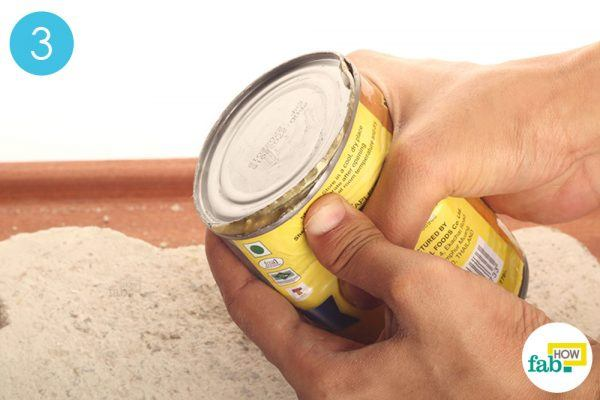 press the sides of the can