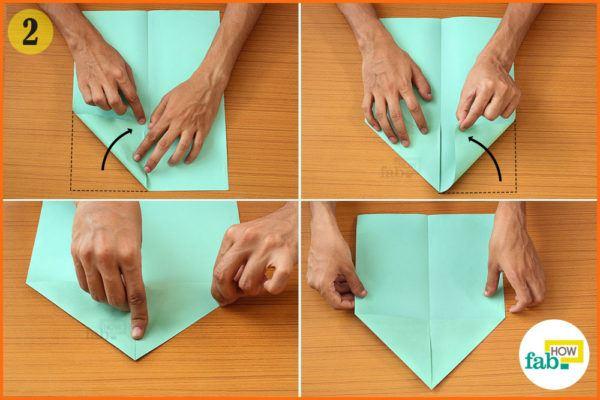 Fold the top two corners