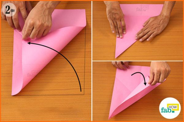 Fold top corners into side edges