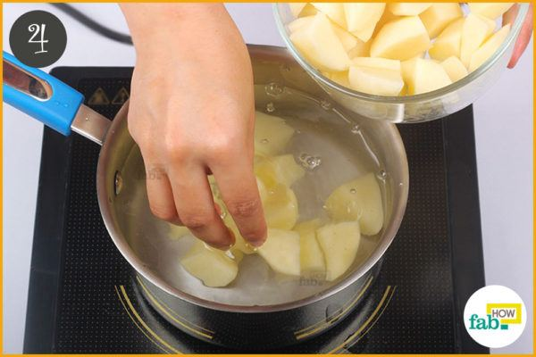Put the potatoes into the pan