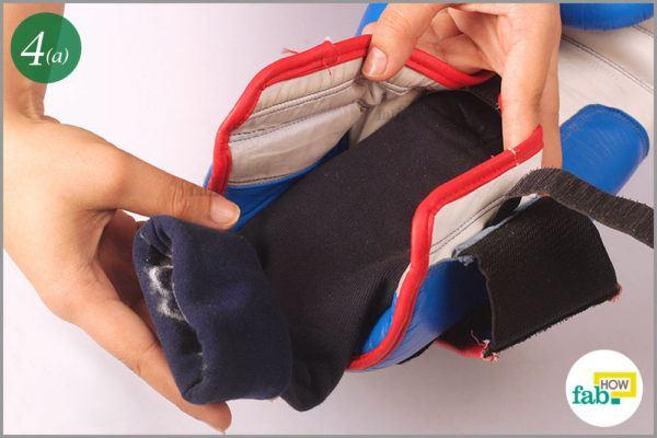 Insert stuffed socks inside gloves