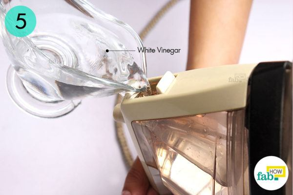 Fill the water reservoir with white-vinegar