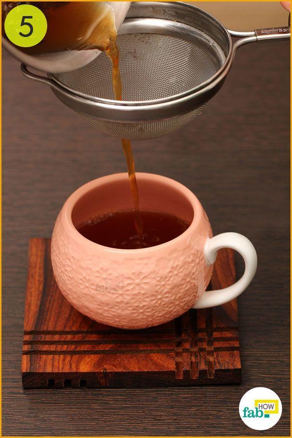 Strain tea into a cup