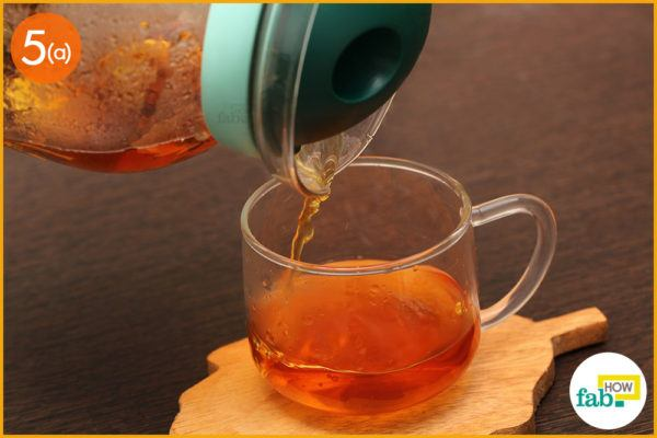 Pour tea into a cup