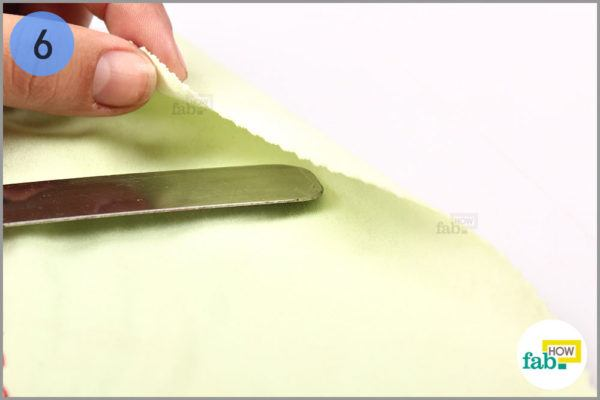 Cover a waxing knife with a microfiber cloth