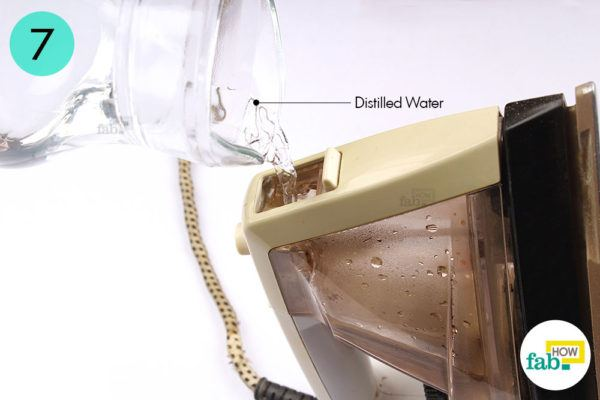 Fill the water reservoir with distilled water