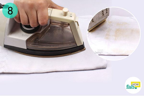 Steam iron the towel