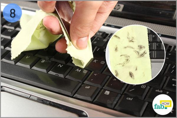 Use the covered knife to deeply clean between the keys