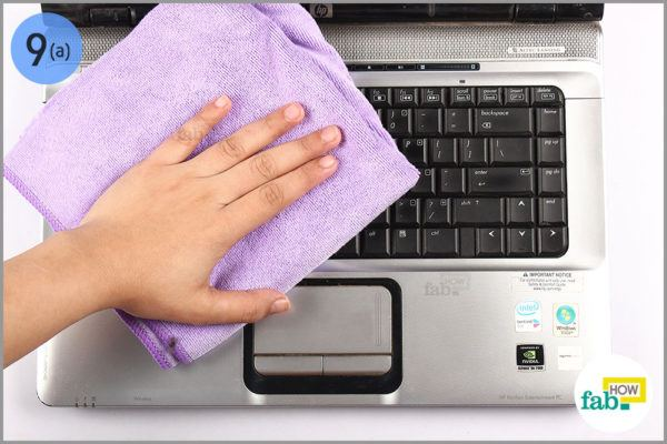 Wipe keyboard with a lint free towel