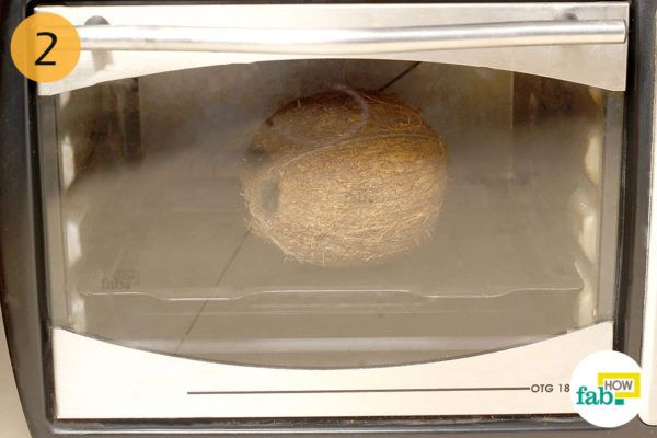 Step-2. Put the coconut in preheated oven for 15 minutes