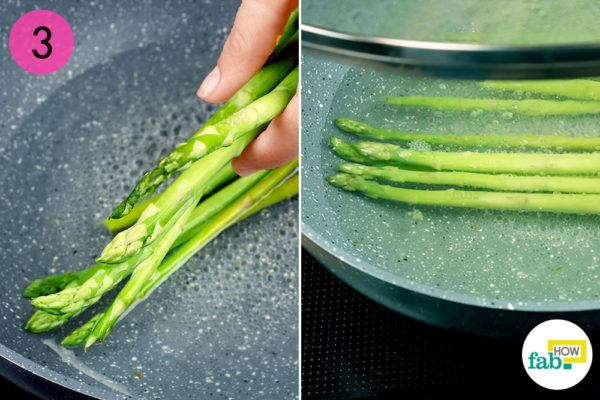 Put the asparagus in the pan