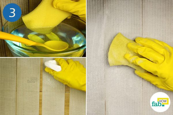 Sponge the blinds with the cleaning solution