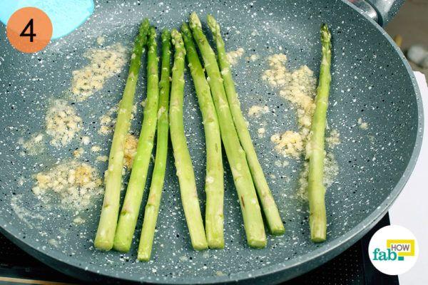 Fry the asparagus