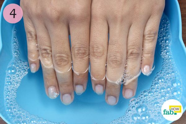 Step-4. Soak your nails in the soapy water