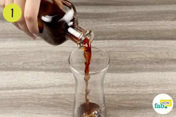 Pour the brewed coffee into a tall glass
