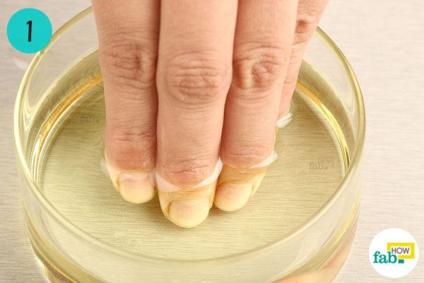 Soak your fingers in warm olive oil to strengthen brittle nails