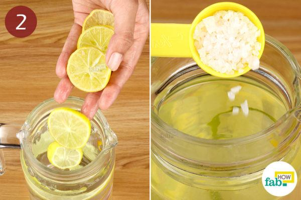 Add lemon slices and pink Himalayan salt to the water