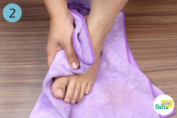Wipe your feet with a towel