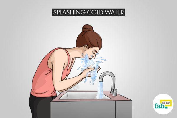 splashing cold water for staying awake